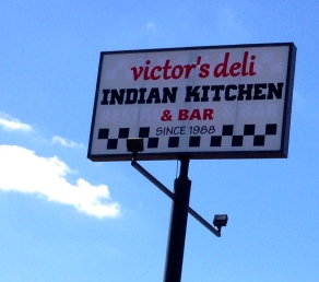 Sign for Victor's deli and Indian Kitchen and Bar. ALl rights reserved. Copyrighted. NO permissions granted