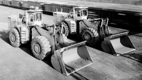 Two parked front end loaders. LoC (Lowe) HALS/USPD: Nat.Parks Service employee/Commons.wikimedia.org)
