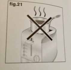 toaster instruction illustration showing Do not boil water in pot on top of toaster. Krups