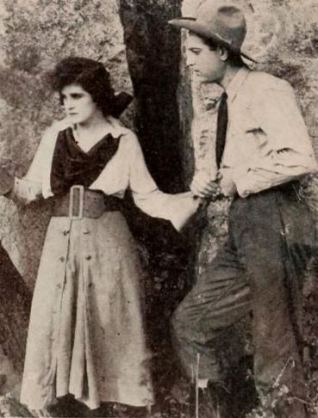 Confused woman holding hands with cowboy. 1919. Sunset pictures/Triangle Picture. (USPD.pub.date/Commons.wikimedia.org)