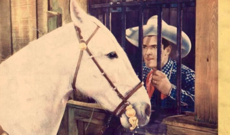 Cowboy talking to his horse, Tarzan, between bars. Universal film movie poster (USPD: pub.date, artist life/Commons.wikimedia.org)