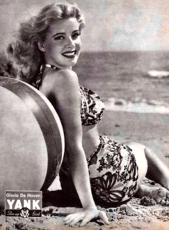woman in glamour pose sitting on beach (1945. actress Gloria DeHaven, Yank, the Army Weekly magazine. USPD, pub.date, fed.army employee/Commons.wikimedia.org )