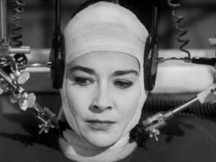 "Woman with scientific equipment attatched to her head. Virginia Leith in film ""The Brain That wouldn't die"" 1962 (USPD. Pub.date/Commons.wikimedia.org)"