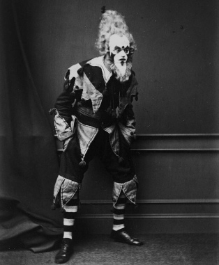 man in oddly threatening clown costume. 1868-169. Weir Collection/Nat.Lib.of Scotland (USPD.pub.date, artist life/Commons.wikimedia.org)