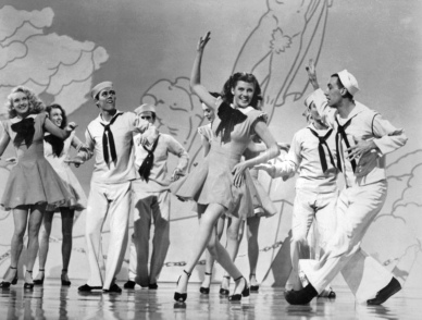 people dancing. 1945 film Tonight and Every Night. Rita Hayworth. Time, Inc/Columbia Pictures (USPD.pub.date, artist life/Commons.wikimedia.org)