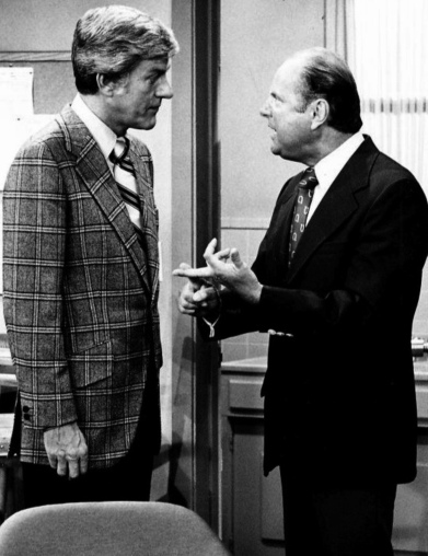 Men in suits talking in office. Pre 1978. DIck Van Dyke Show publicity photo. (USPD.pub.date, no cr markings/Commons.wikimedia.org)