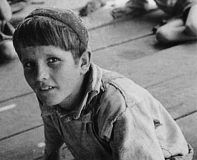 Young boy looking into camera. 1944. William Tengle/Hale County/ (Walker Evans photographer. LoC/USPD. by gov. employee, pub.date/Commons.wikimedia.org)