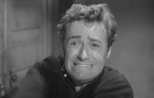 Man. Frightened face. Actor Dick Miller in film Bucket of Blood. 1959 (USPD: pub.date/Commons.wikimedia.org)
