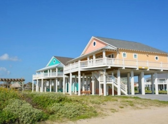 Some of the new beach houses built after Hurricane Ike. Owning a beach house sounds like such a good idea - until memories of September storms float to the surface. Maybe beach houses are like horses: best if your neighbor has one and is willing to share. (Image: boliverpeninsulatexas.com)