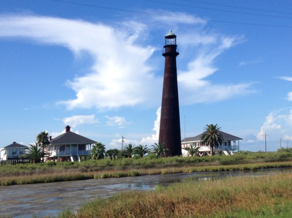 Lighthouse among keeper's cottages and marsh.. Point Bolivar Lighthouse on Bolivar Peninsula, TX. (ALL rights reserved. Copy righted, NO permissions granted)