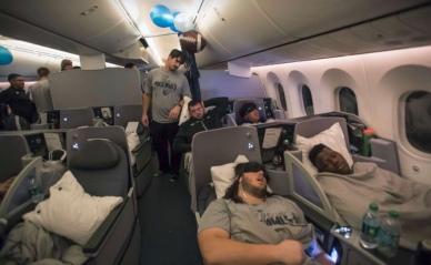 RIce football players sleeping on plane. (T.Lavergne/RIce Athletics/Hou Chron)
