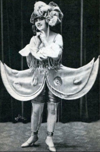Woman in weird costume. Christine Welford. 1921 Broadway musical still. The Tatler mag, Aug, 1921 (USPD.pub.date, artist life/Commons.wikimedia.org)