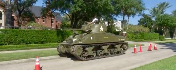 military tank parked on neighborhood street. (Screenshot khou).