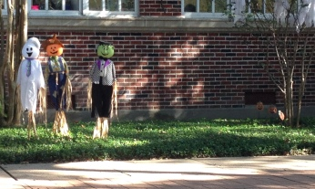 Halloween scarecrows outside a red brick school (Image©. ALL rights reserved, no permissions granted, Copyrighted)
