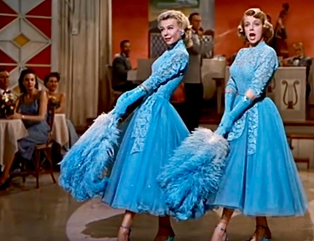 Two women. Actresses in vintage cocktail dresses on stage (Screenshot of Hanes sisters' act in White Christmas movie. Source: YouTube)