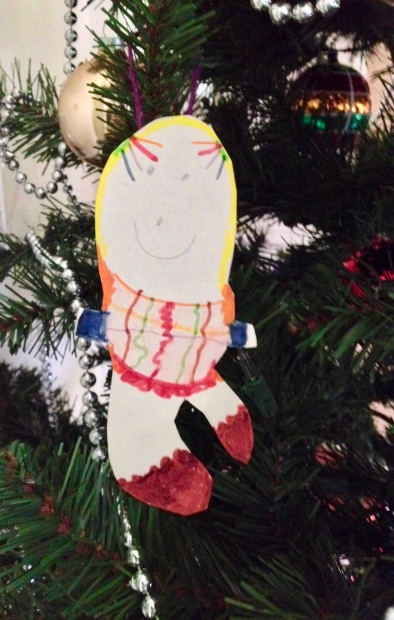 Paper Christmas angel drawn by preschooler hanging on Christmas tree. (Image: all rights reserved. NO permissions granted, copyrighted)