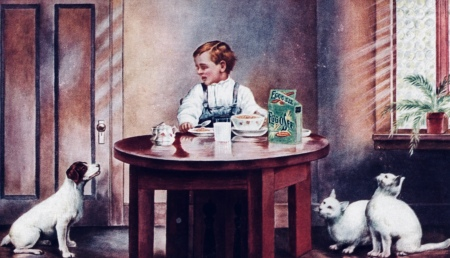 1907 advertisememnt. Boy at table looking at dog and cats.1097(USPD. pub.date, artist life/Commons.wikimedia.org)