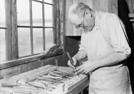 Man carving wood trim. 1936-37 (USPD. NARA. by fed. employee, Hine, Pub.date/Commons.wikimedia.org)