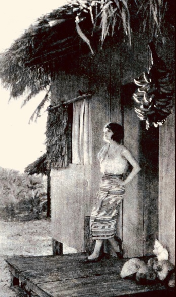 Woman outside grass hut. 1922 Film Fun/ pub.photo (USPD. pub.date, artist life/Commons.wikimedia.org)