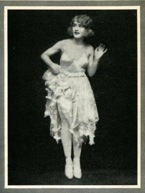 Woman in fancy dress flirting and waving. MAry Eaon. Ziegfeld Follies, 1922/The Tattler mag, Feb. (USPD. artist life, pub.date4/Commons.wikimedia.org)