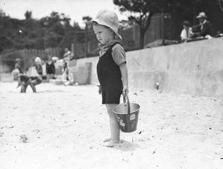 Boy with sand bucket at beach. 1935 (Sam Hood/State Lib. of New South Wales/PD/Commons.wikimedia.org)