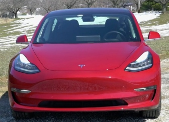 Front view of red 2018 Tesla Model 3 (Image Motorweek YouTube screenshot)