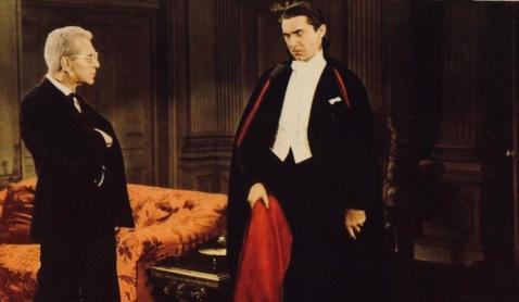 Vampire Dracula looking at man. 1931 film. (USPD. pub.date, artist life/Commons.wikimedia.org