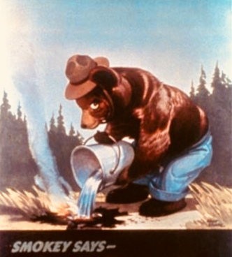 Smokey the Bear dousing camp fire. 1944 (USPD. by fed. employee/Commons.wikimedia.org)