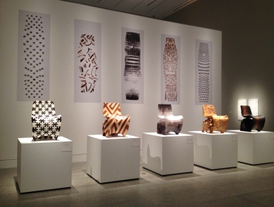 Joris Laarman Lab 3-D printed chairs in front of their open source design panels printed in 2-D. From MFAH exhibit. Image: copyrighted, no permissions granted, ALL rights reserved)