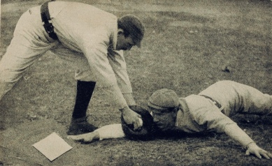 Baseball players at home plate. 1903 (USPD pub.date, aertist life/Commons.wikimedia.org)
