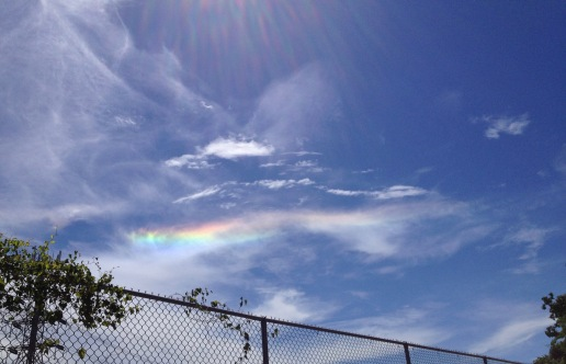 Rainbow streaming horizontally across sky. (© Image all rights reserved, copyrighted, NO permissions granted)