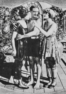Man and 2 Women in vintage bathing suits. 1920 Paramount Pictures (USPD. pub.date/Commons.wikimedia.org)