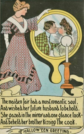 Vintage woman looking into mirror tio see couple kissing. Halloween greeting card. Vintage. T.R.Co. NYpub.library (USPD.pub.date/Commons.wikimedia.org)