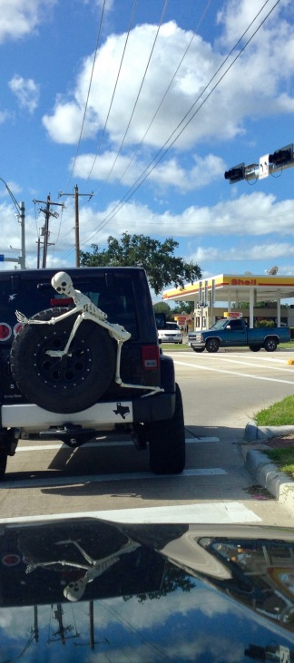 Halloween skeleton clinging to back of Jeep. (© Image: all rights reserved, copyrighted, no permissions granted)