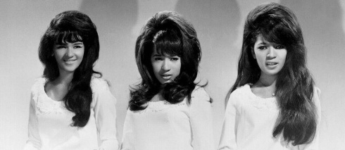 three women in big hair styles 1966 (USPD/GAC publicity photo of the Ronnettes/Commons.wikimedia.org)