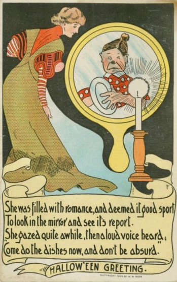 Woman looking in mirror only to see dishwasher.Vintage Halloween greeting card. NYPub.library(USPD.pub.date/Commons.wikimedia.org)