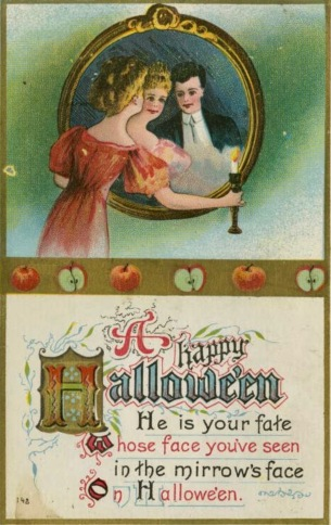 Woman with candle looking in mirror to see man's face. Halloween postcard. USPD/Commons.wikimedia.org)