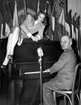Vintage couple. 1945, Lauren Bacall on piano as VP Harry S. Truman plays (Time, inc.Charles Cort/Life Mag. (USPD pub.date, artist life/Commons.wikimedia.org)