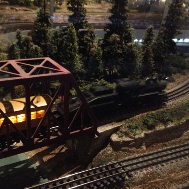 vintage model railroad display at Houston Museum of Natural Science. Black engine crossing bridge. (© image copyrighted, no permissions granted, All rights reserved)