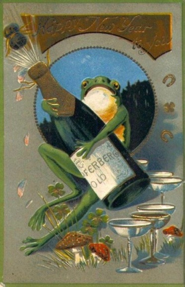 Frog holding champagne bottle with glasses at his feet and small clovers and horse shoes for good luck. 1908 post card for New Years(USPD. artist life, pub.date/Commons.wikimedia.org)