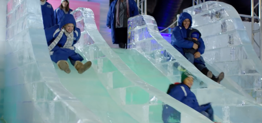Children on ice slide at 2018 Ice Land at Moody Gardens (Screenshot)