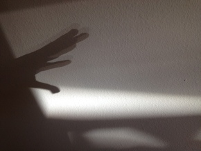 Hand reaching into shadows. (© image,: all rights reserved, copyrighted, NO permissions granted )