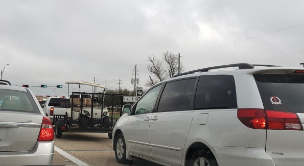 angry golf cart caged in traffic. (© image: Copyrighted, all rights reserved, NO permissions granted)