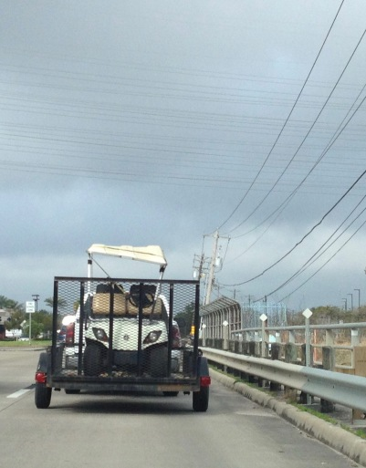 Angry golf cart on bridge (© image: copyrighted, no permissions granted, all rights reserved)