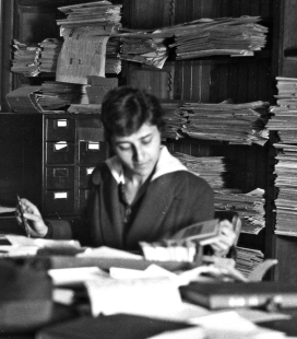 Woman at messy desk. 1919 Iowa State College. (Image Father of Don O'Brien/wikimedia.org)
