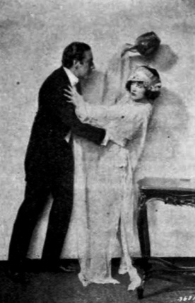 Man and woman fighting. (Universal Films, 1921/Exhibitors Herald 1921-1922/USPD.pub.date, artist life/Commons.wikimedia.org)