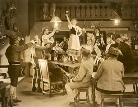 Crowd drinking in Swiss Alpine Inn. (1919. Metro Pictures/USPD.pub.date, artist life/Commons.wikimedia.org)