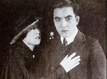 Expressive couple. (1919. publicity still/ Exhibitors Mutual/Robertson-Cole/USPD.pub.date, artist life/Commons.wikimedia.org)