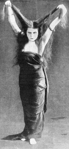 Strange woman with long hair. (Theda Bara, 1915 vampire pose/Fox Film/Underwood photo/USPD. pub.date, artist life/Commons.wikimedia.org)