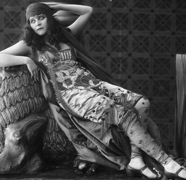 reclining woman. Theda Bara in Salome, 1918/USPD. pub.date, artist life/Commons.wikimedia.org)